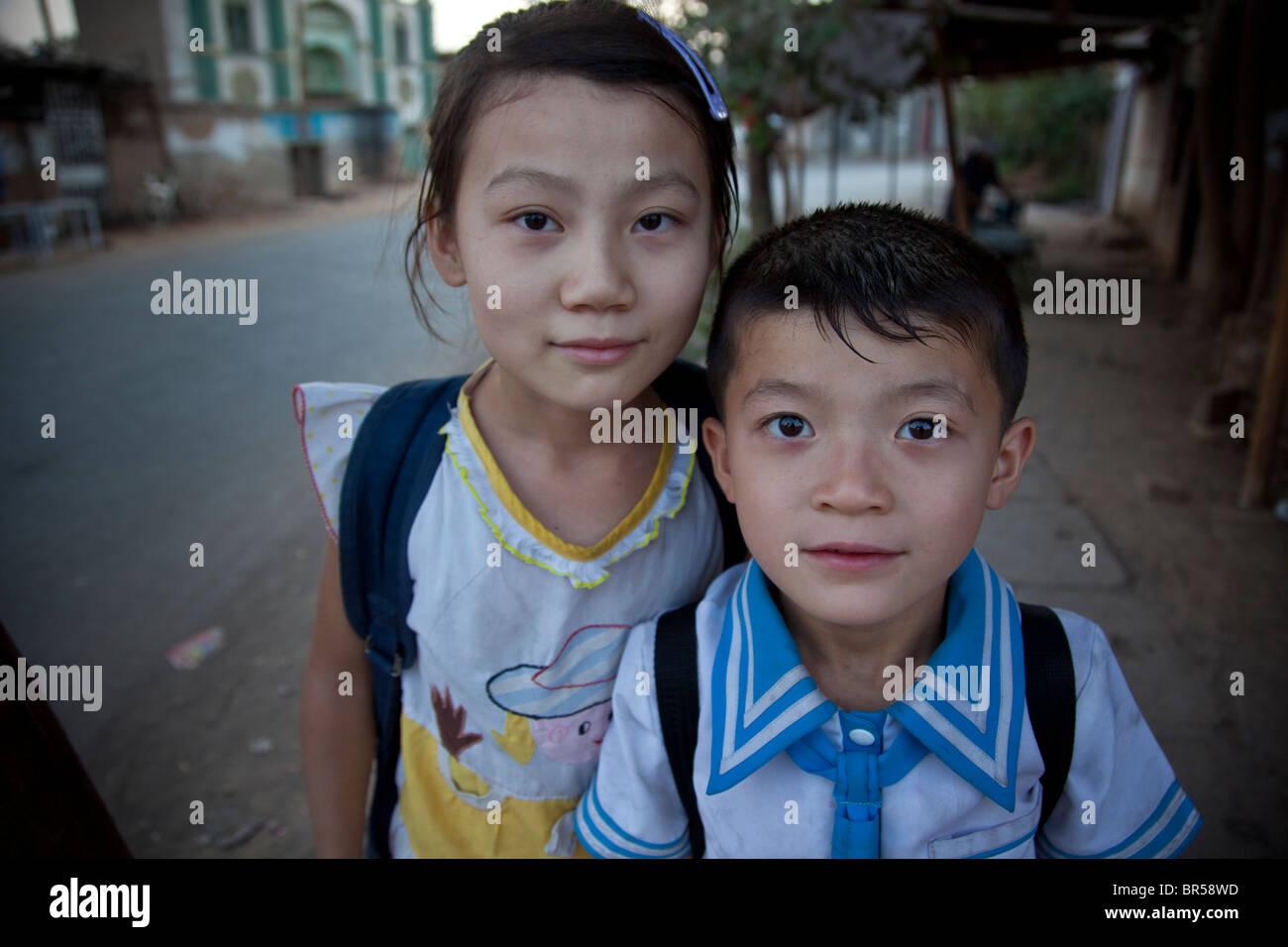 Boy and girl in Turpan Xinjiang China. - Stock Image
