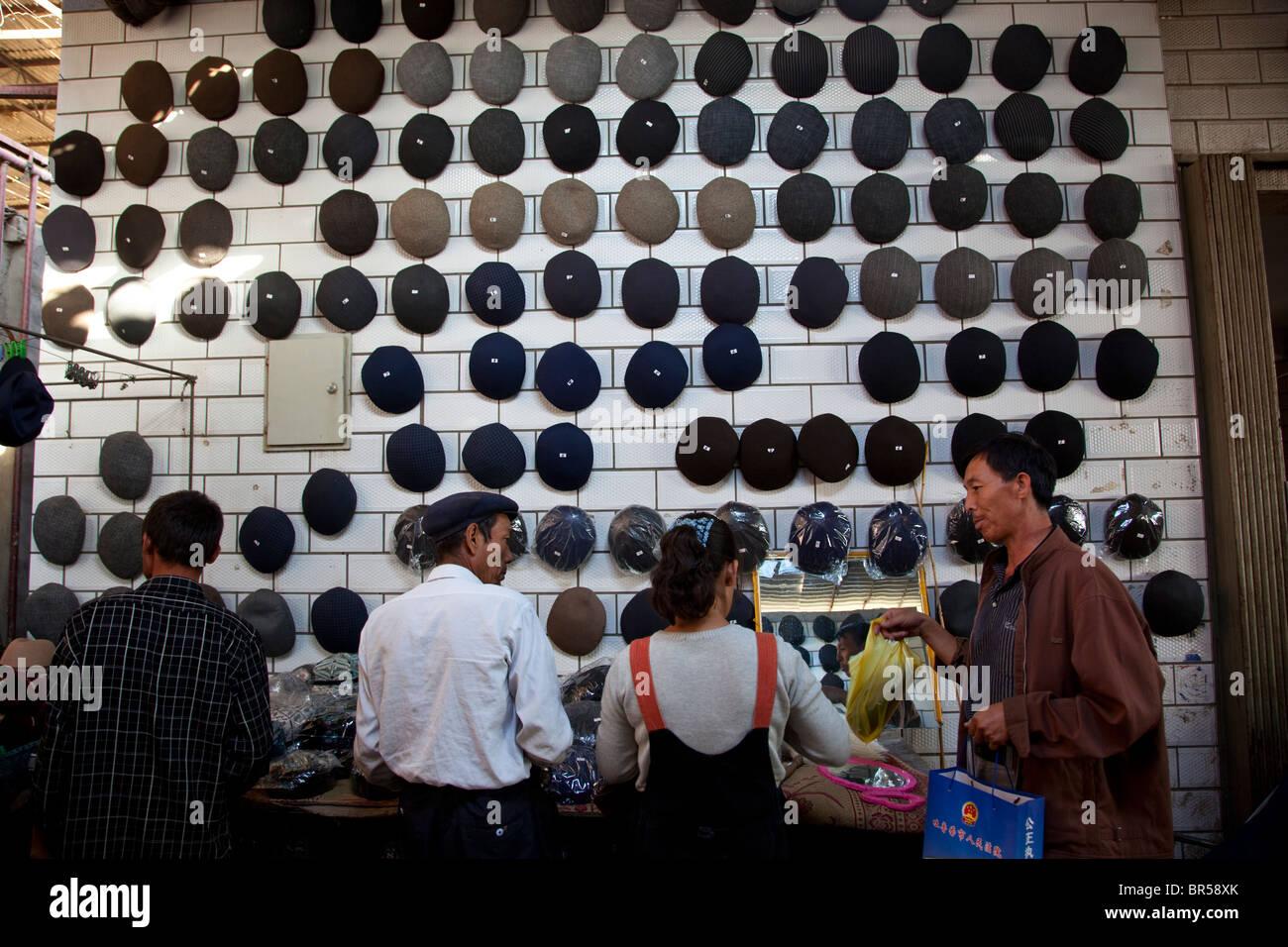 Hats for sale at bazaar in Turpan Xinjiang China. - Stock Image