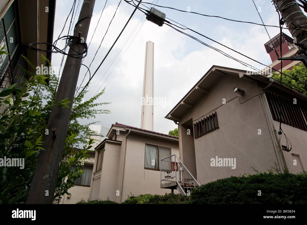 Shibuya Seisoh Kojo (garbage incinerator plant) with it's large chimney, in Shibuya district in Tokyo, Japan - Stock Image