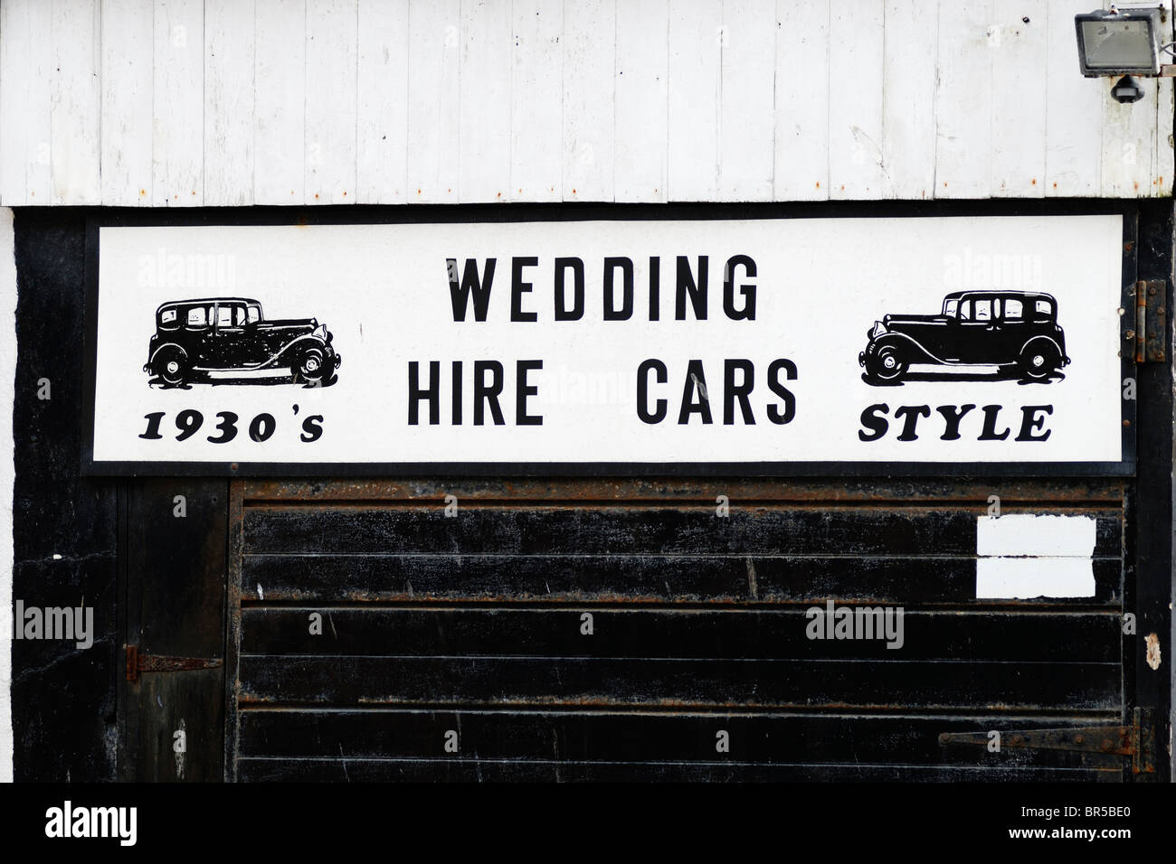 Sign advertising the hire of 1930's style wedding cars, Aberystwyth, Wales. - Stock Image