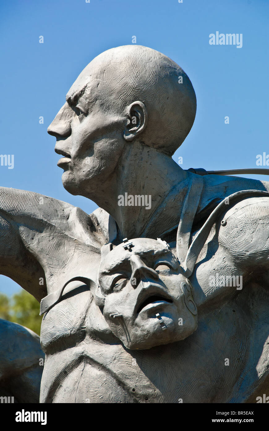 'The Chase' cast stainless steel sculpture in front of the Barber Vintage Motorsports Museum in Birmingham, - Stock Image