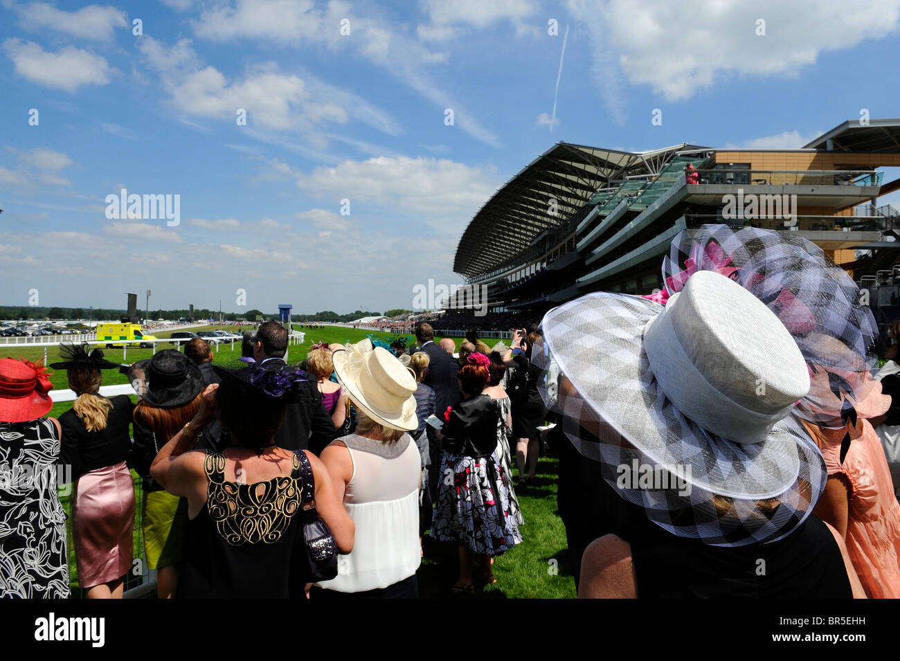 View of race goers watching a race in the grandstand enclosure during day three of Royal Ascot 2010 - Stock Image