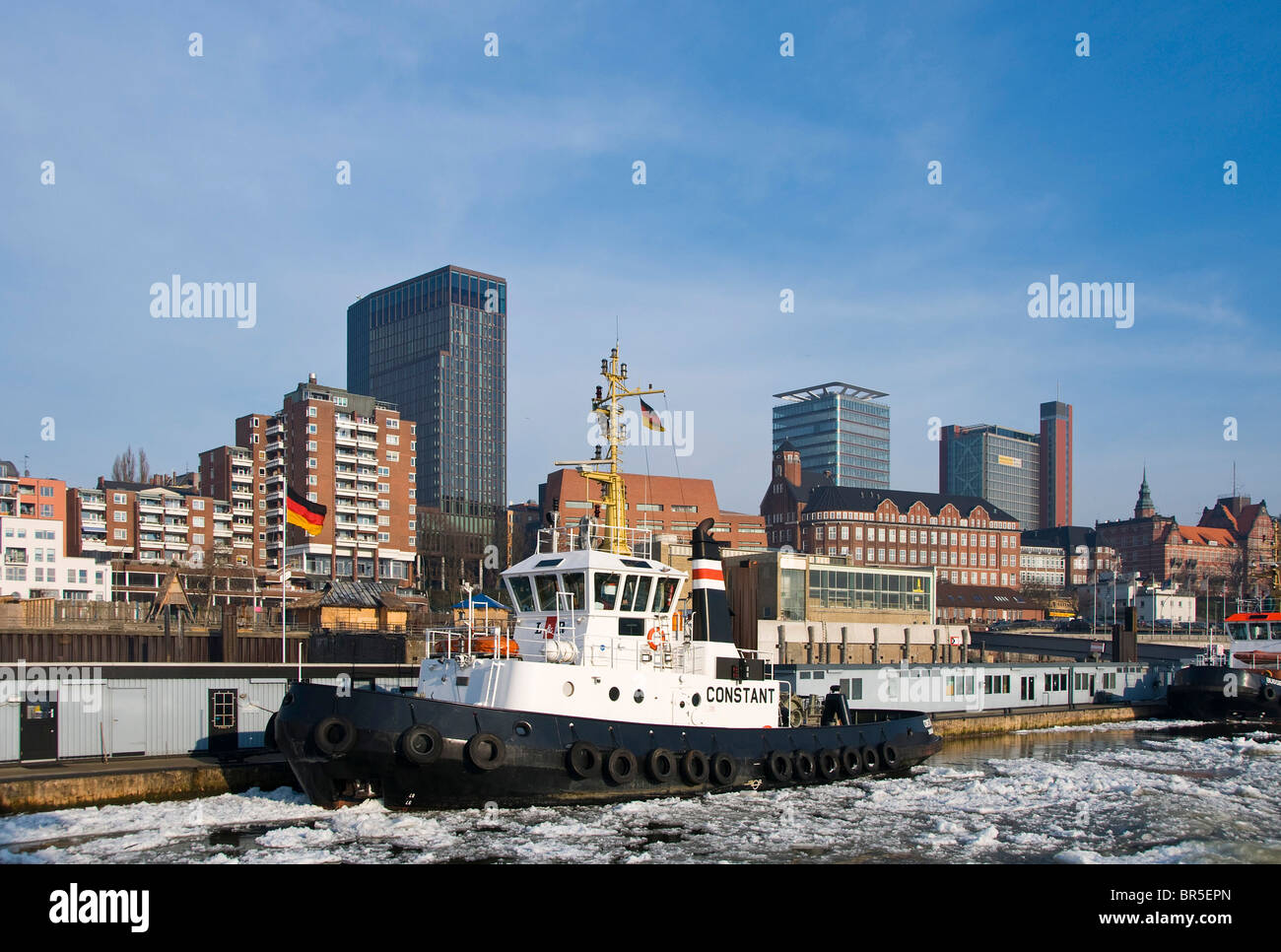 Harbour tug anchored in front of St. Pauli at the Port of Hamburg, Hamburg, Germany, Europe - Stock Image