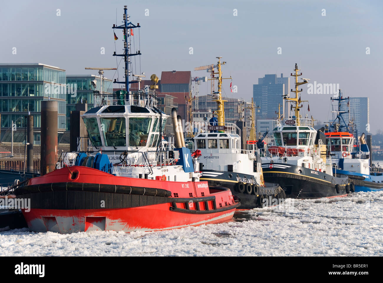 Harbour tugs anchored in front of Altona at the Port of Hamburg, at back the Elbperlen, Hamburg, Germany, Europe Stock Photo