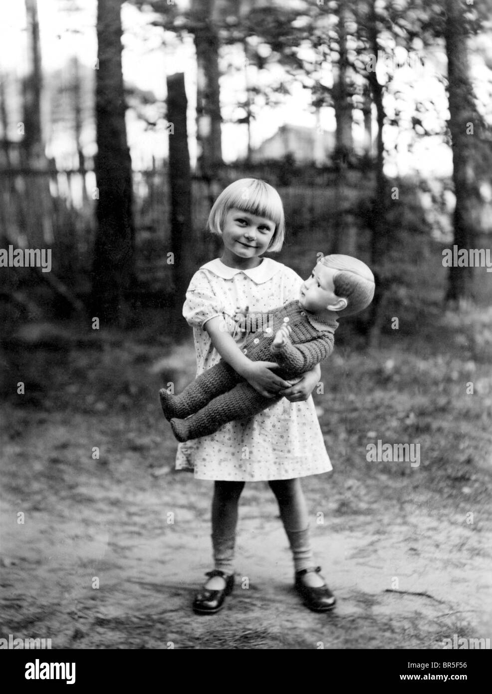 Historic photograph, girl with a doll, around 1926 - Stock Image