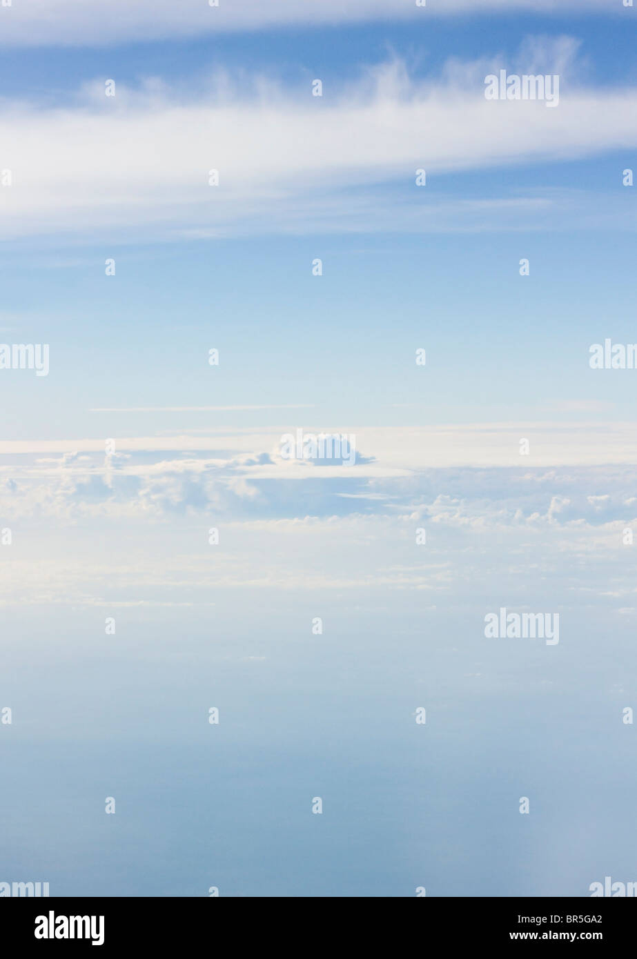 Blue skies with soft white clouds - Stock Image