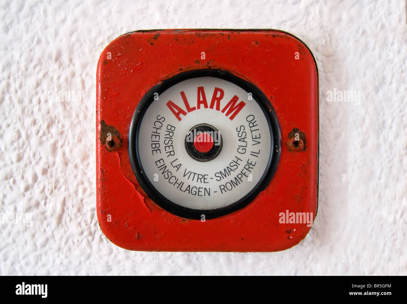 Old fire Alarm. In case of a fire break the glass and set the alarm. - Stock Image