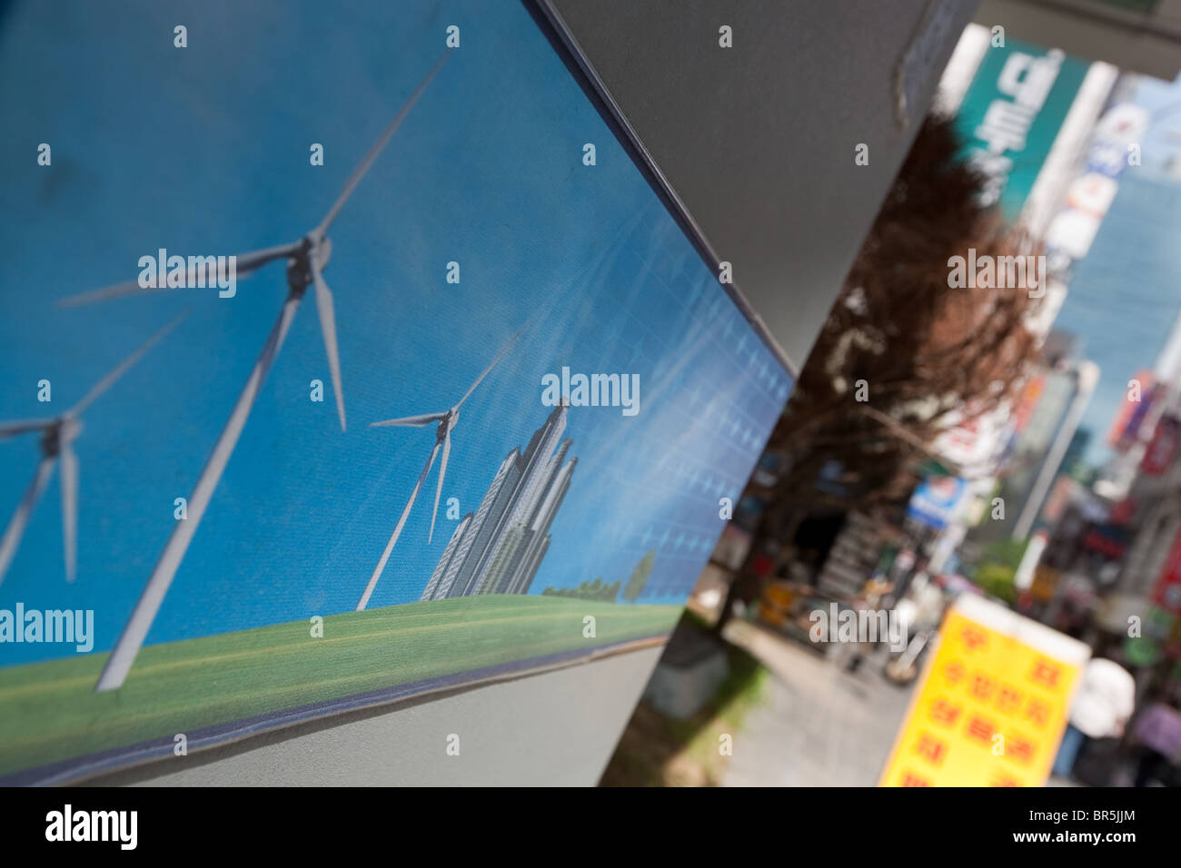 Poster advertising green renewable sustainable wind power energy in Seoul, South Korea, Friday 27th August 2010. - Stock Image