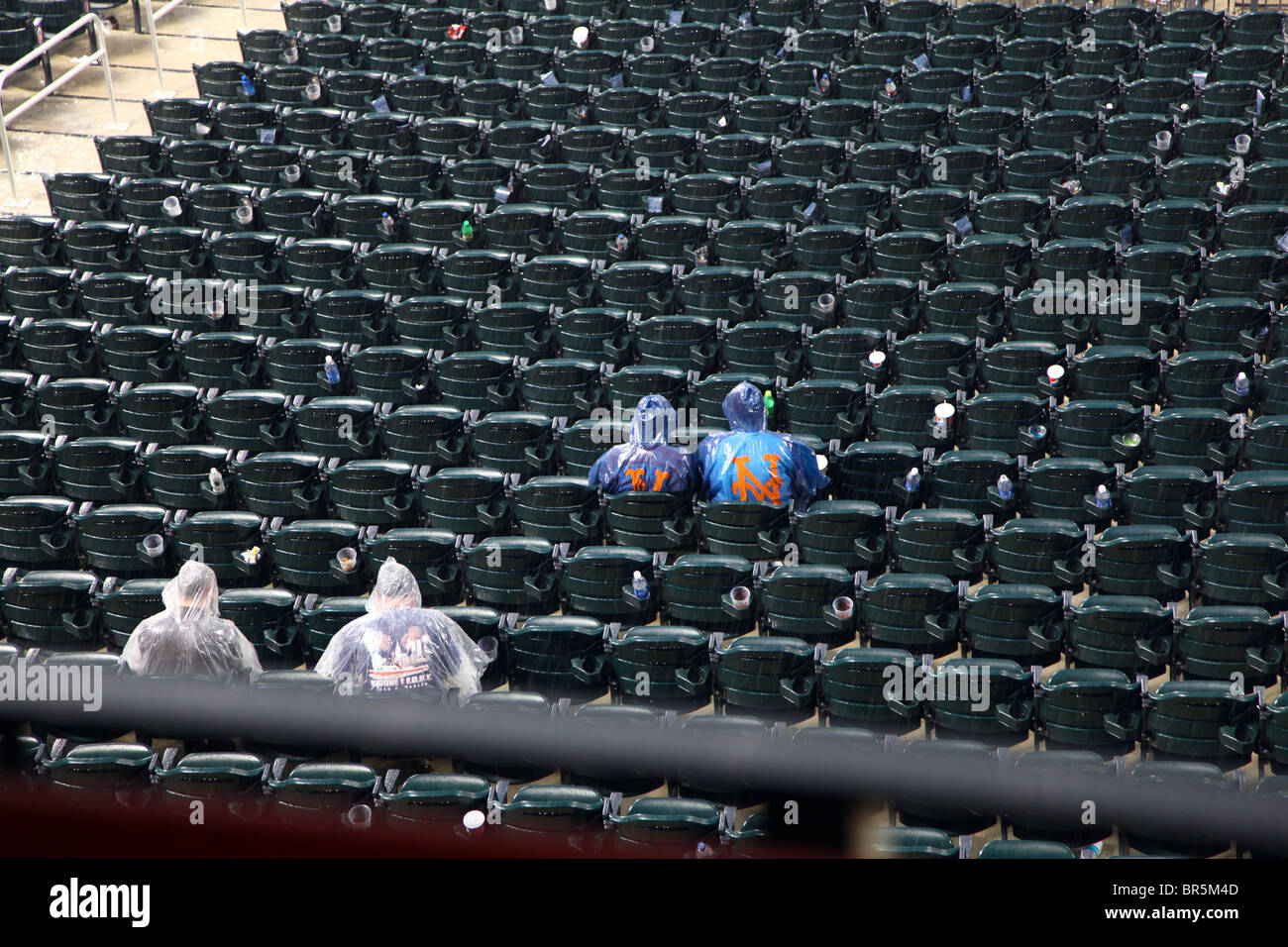 Mets fans sitting in the stand during a rain delay, Queens, NY, USA - Stock Image