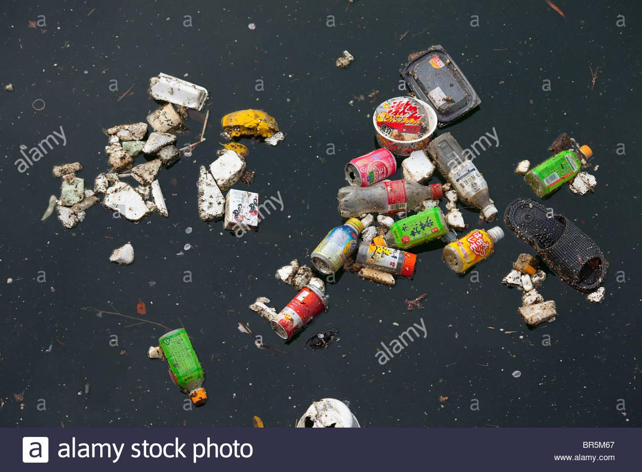 Trash on a river, Tokyo, Japan - Stock Image