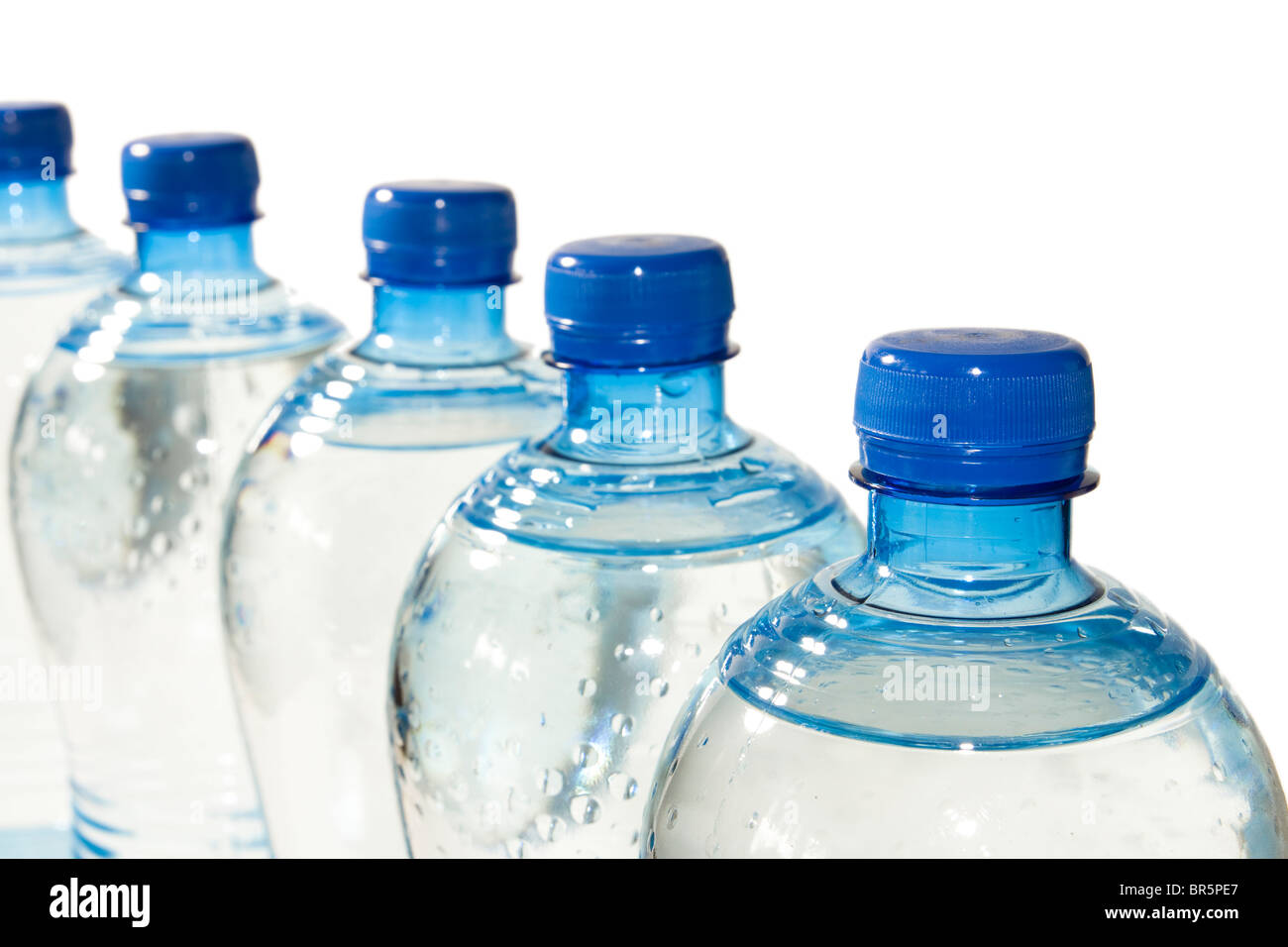 A row of bottles of water isolated on white - Stock Image