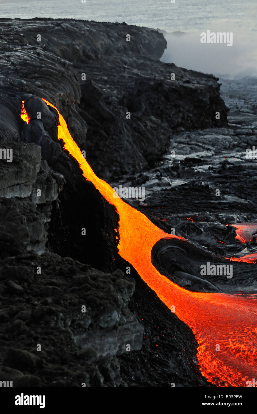 River of molten lava flowing to the sea, Kilauea Volcano, Hawaii Islands, USA - Stock Image