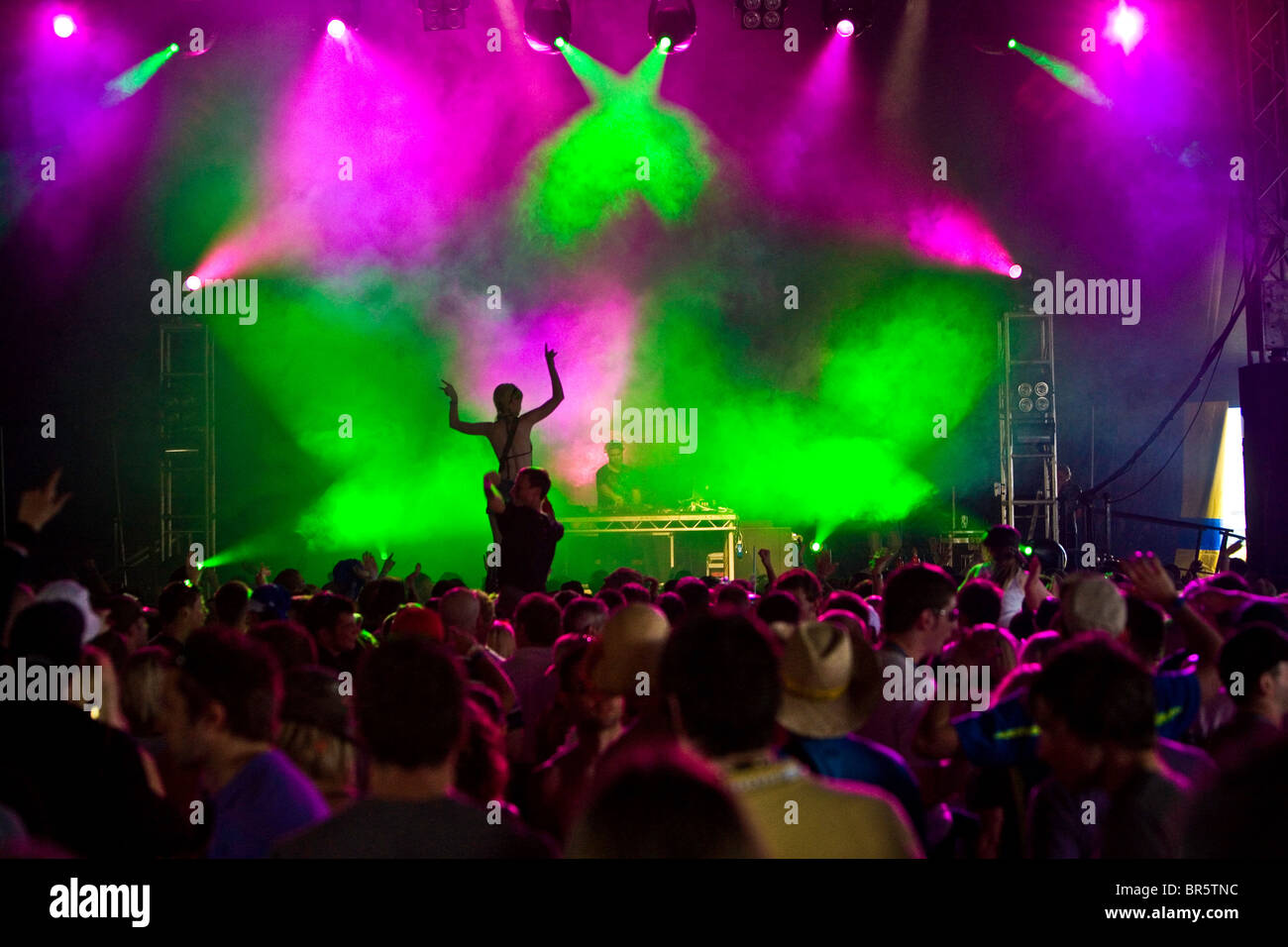 A woman up on shoulders puts her hands in the air during Pete Tong's set, playing Fat Sam's tent, Rockness. - Stock Image