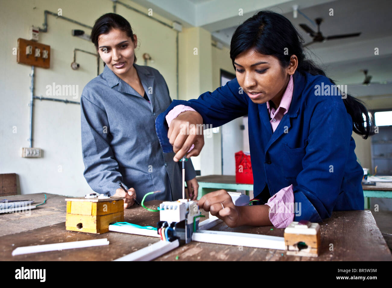 A teenage girl in an electrical class at the Jyoti Vocational Training and Rehabilitation Centre in Nepal. - Stock Image