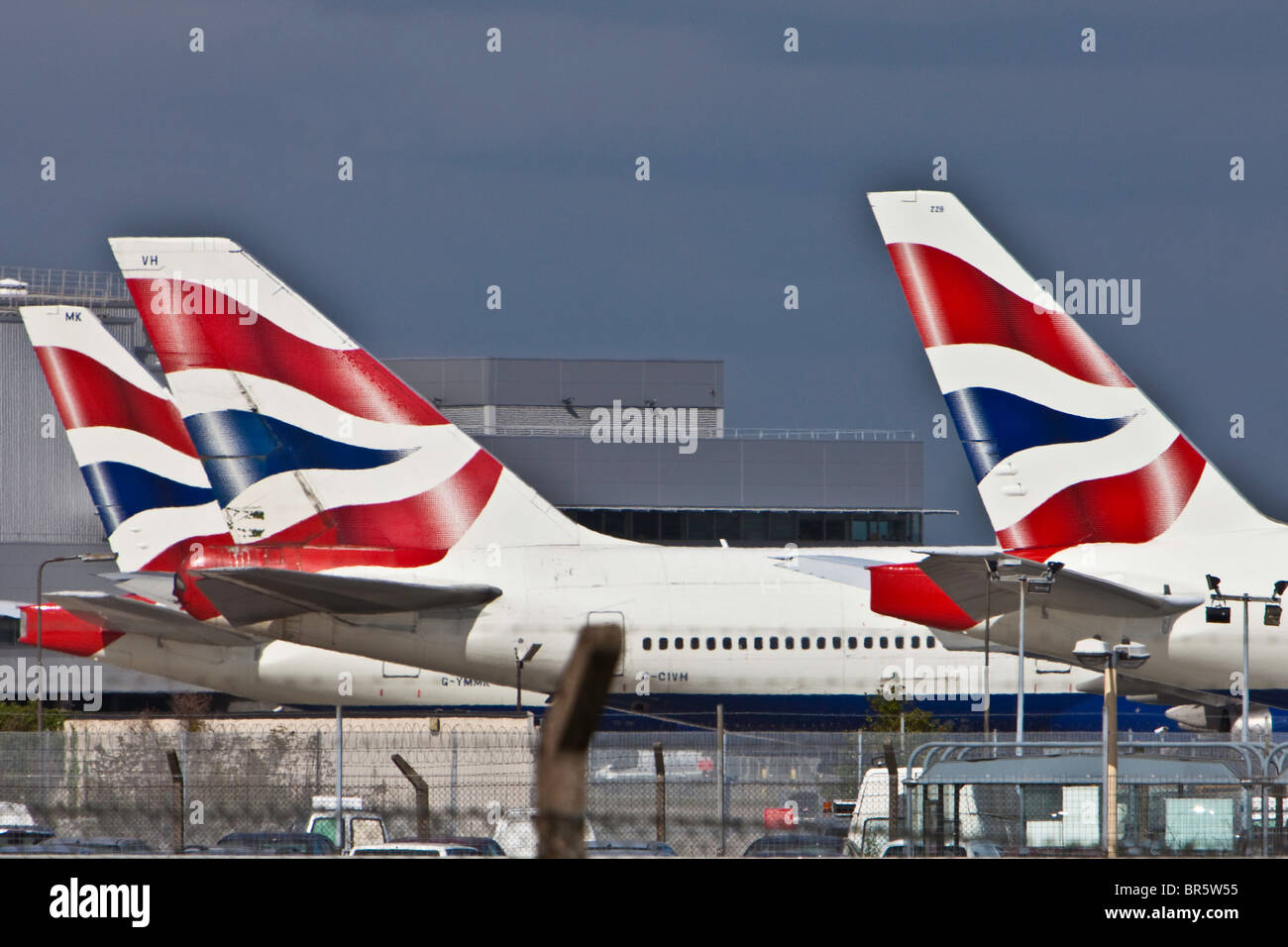 British Airways planes lined up at London's Heathrow Airport. - Stock Image