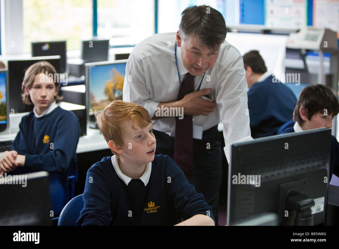 Keith Webber a teacher at Okenhampton College in Devon talks to a student. - Stock Image