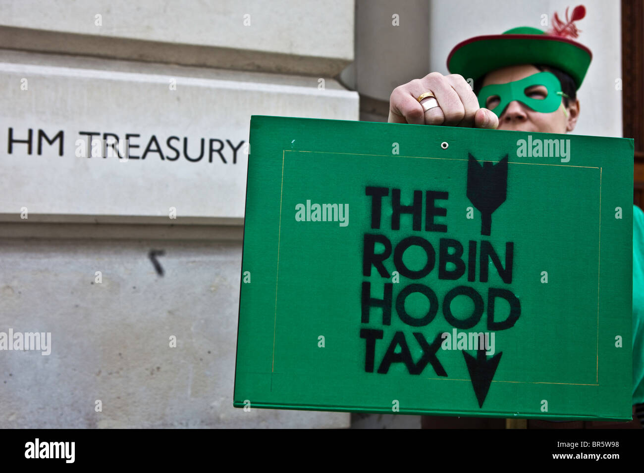 Robin Hood Tax campaign, the green-clad Robin Hoods marched to Parliament. - Stock Image