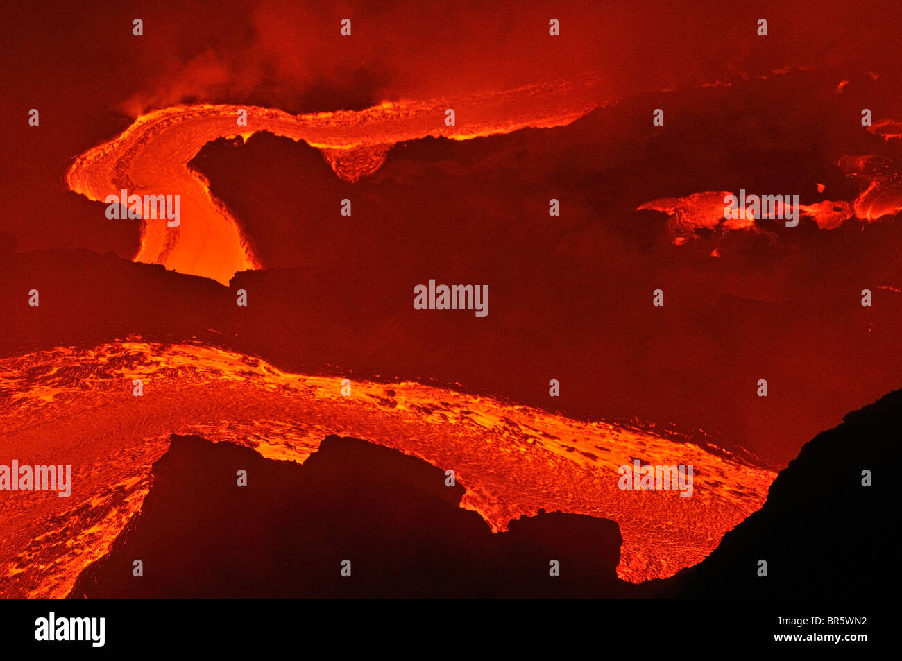 River of molten lava flowing to the sea, Kilauea Volcano, Hawaii Islands, United States - Stock Image