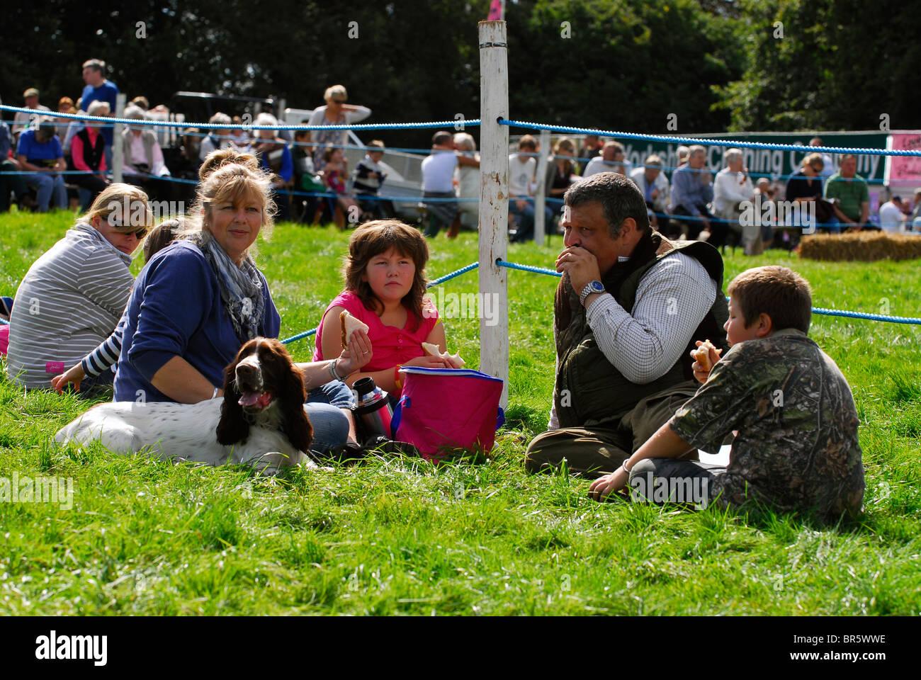 Family picnic at Hampshire County Sports Day, Alresford, Hampshire, UK. - Stock Image