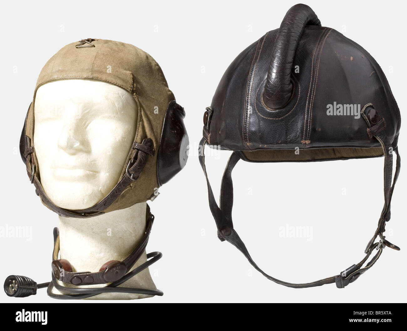 A pilot's flight protection helmet, model SSK 90 Body of riveted steel plates with cover and bulge of brown - Stock Image