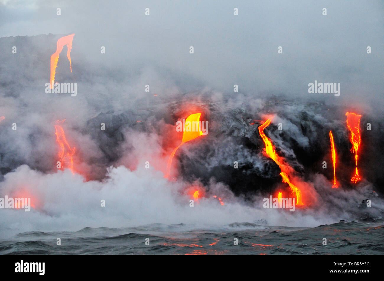 Steam rising off lava flowing into ocean, Kilauea Volcano, Hawaii Islands, United States - Stock Image
