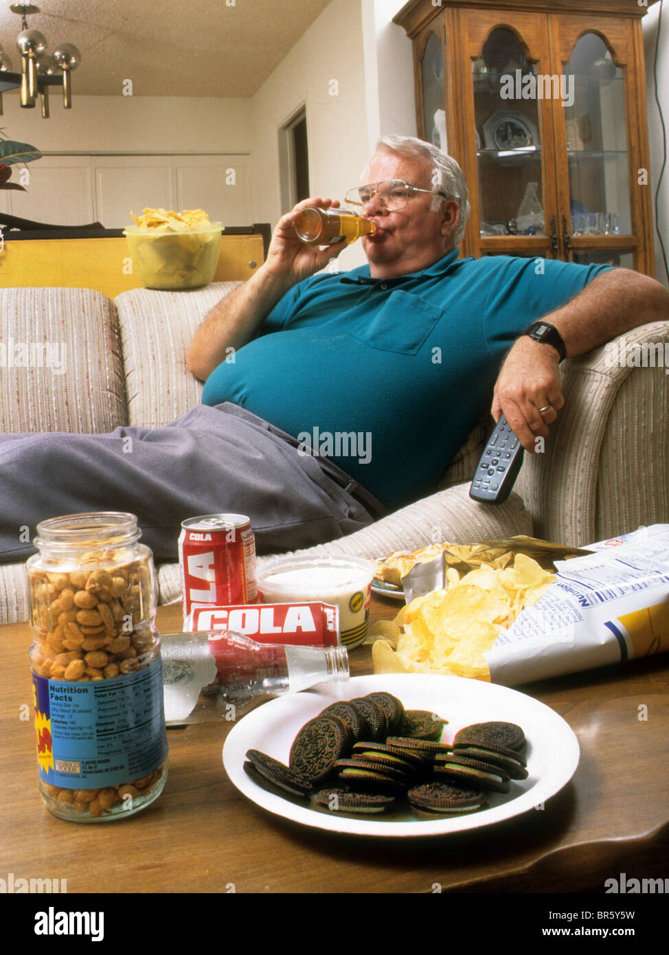 Obese Couch Potato Obese senior man junk ...