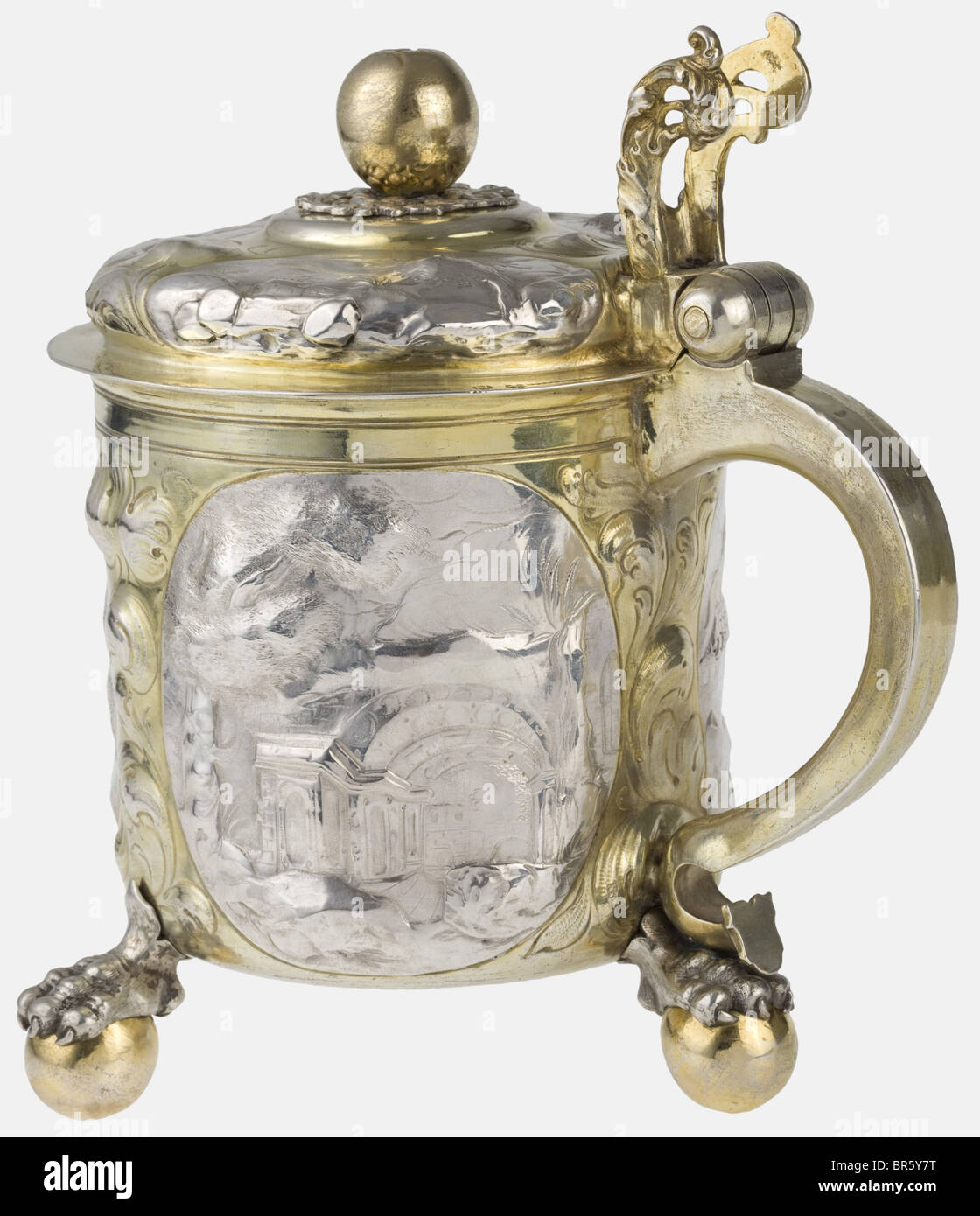 A silver tankard with lid, Nuremberg, circa 1660/70 Silver, partially gilt. Cylindrical body on three claw-and-ball - Stock Image