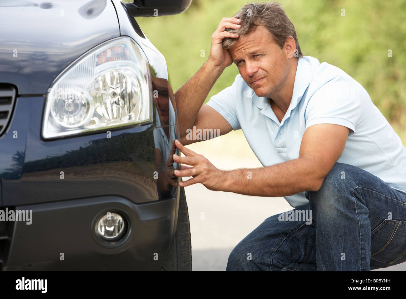 Driver Broken Down On Country Road - Stock Image