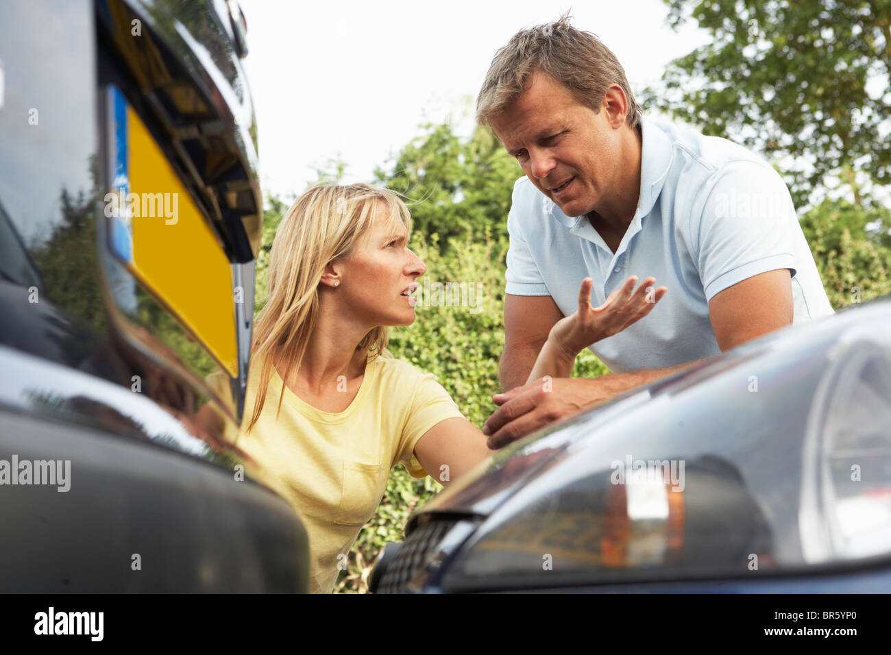 Man And Woman Having Argument After Traffic Accident - Stock Image