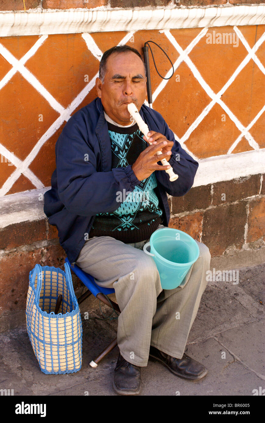 Blind man playing a recorder in the city of Puebla, Mexico. - Stock Image