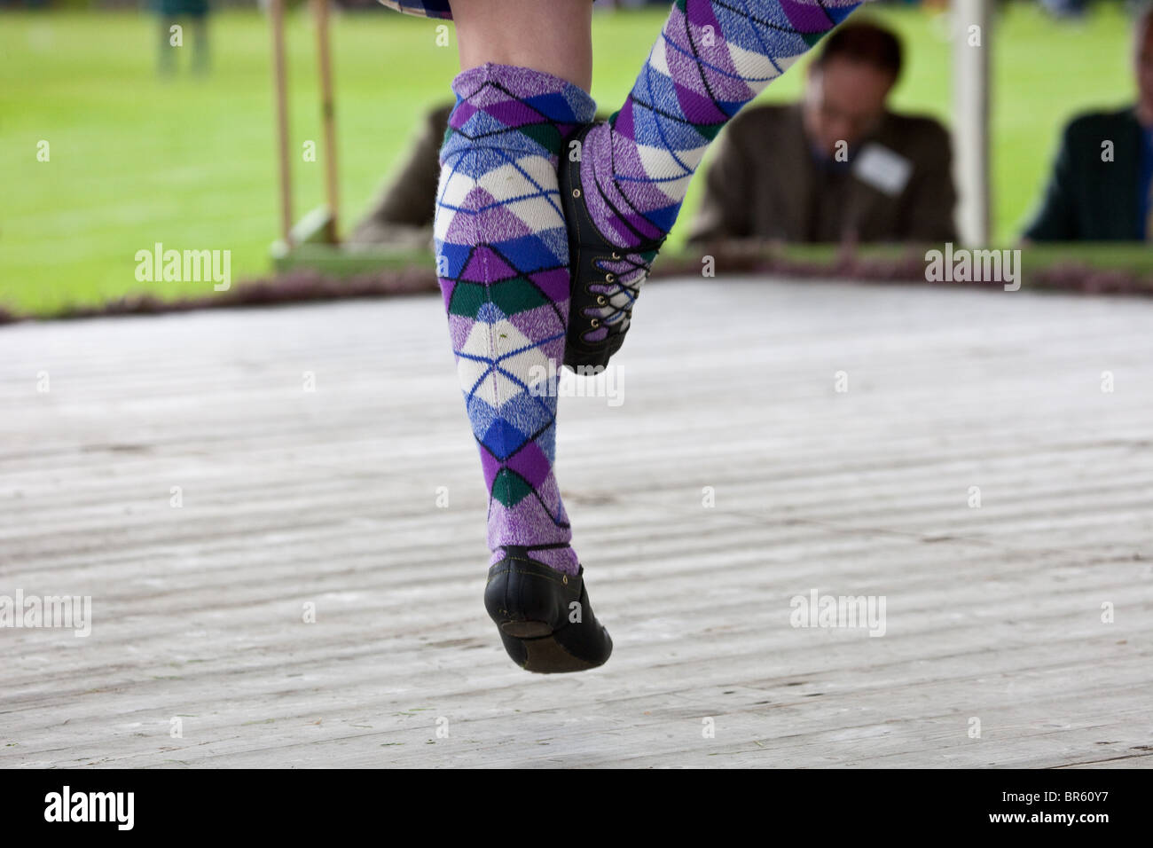 Female Highland reel Dancers, wearing purple socks at the Braemar Royal Highland Gathering and Games  Memorial Park, Stock Photo
