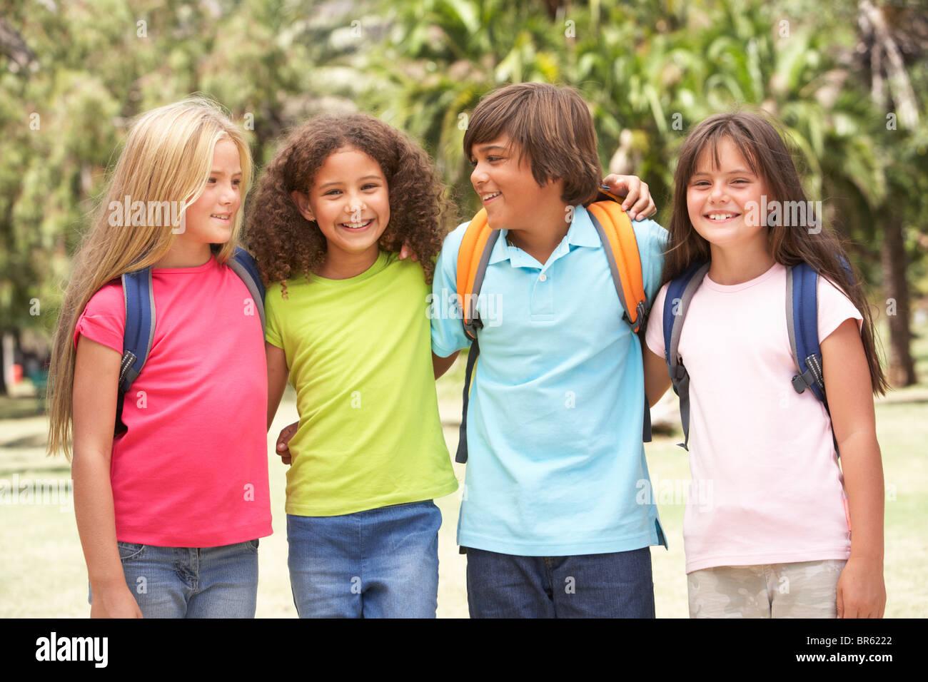 Group Of Schoolchildren Standing In Park - Stock Image