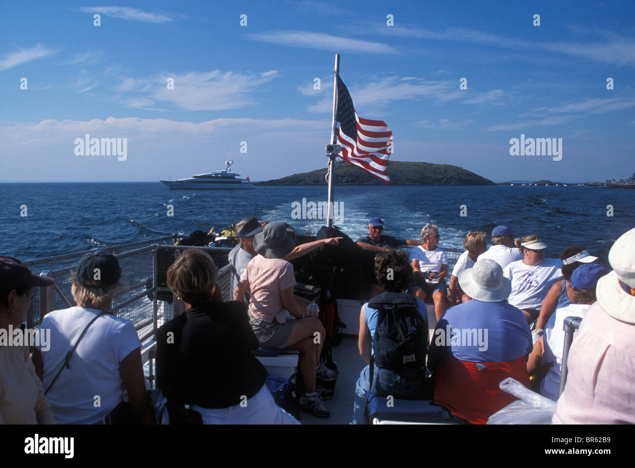 Passengers on a ferry to the picturesque island of Mohegan Central Maine. - Stock Image