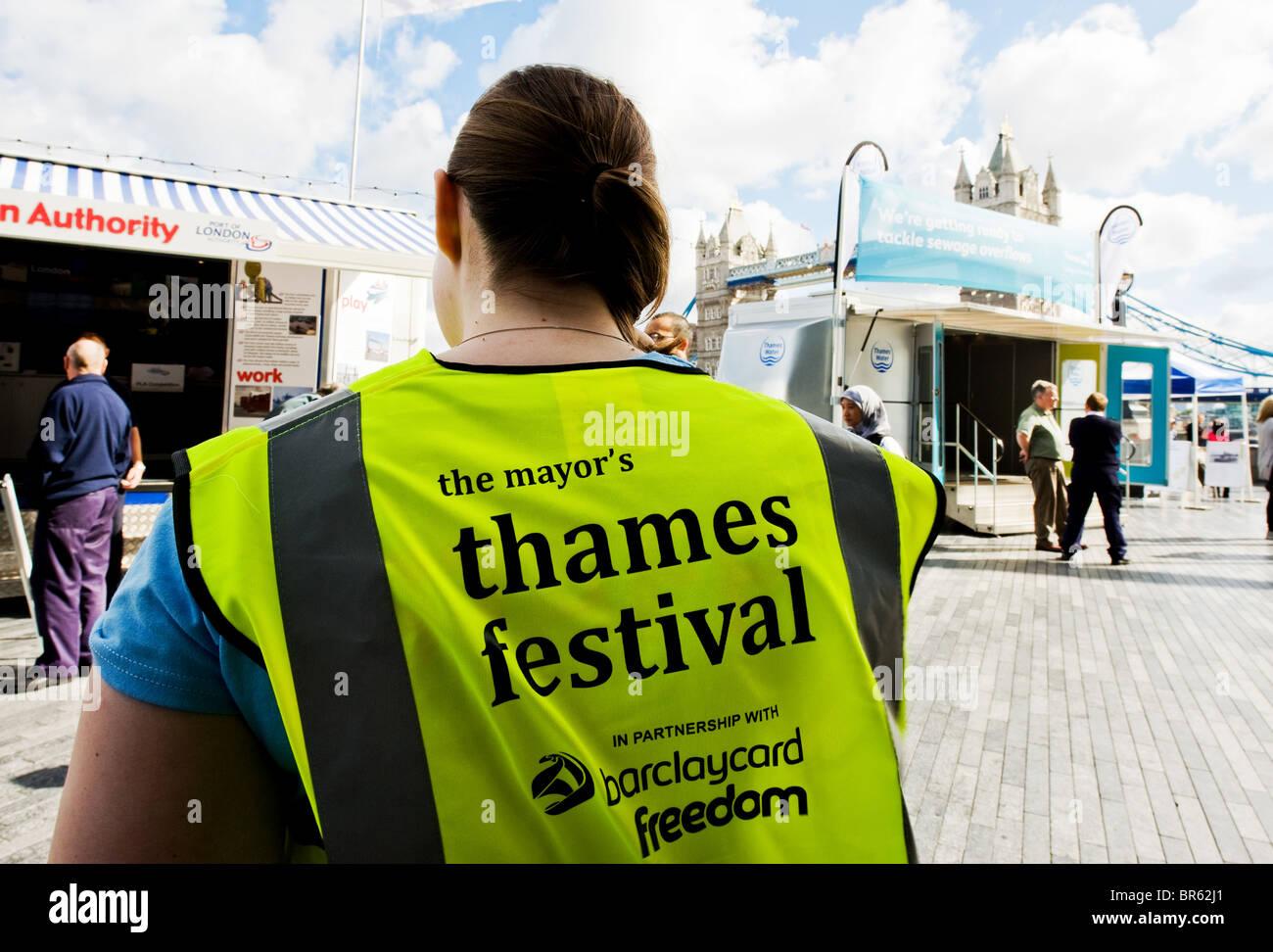 A steward wearing a hi-viz jacket at the Thames Festival in London. Stock Photo