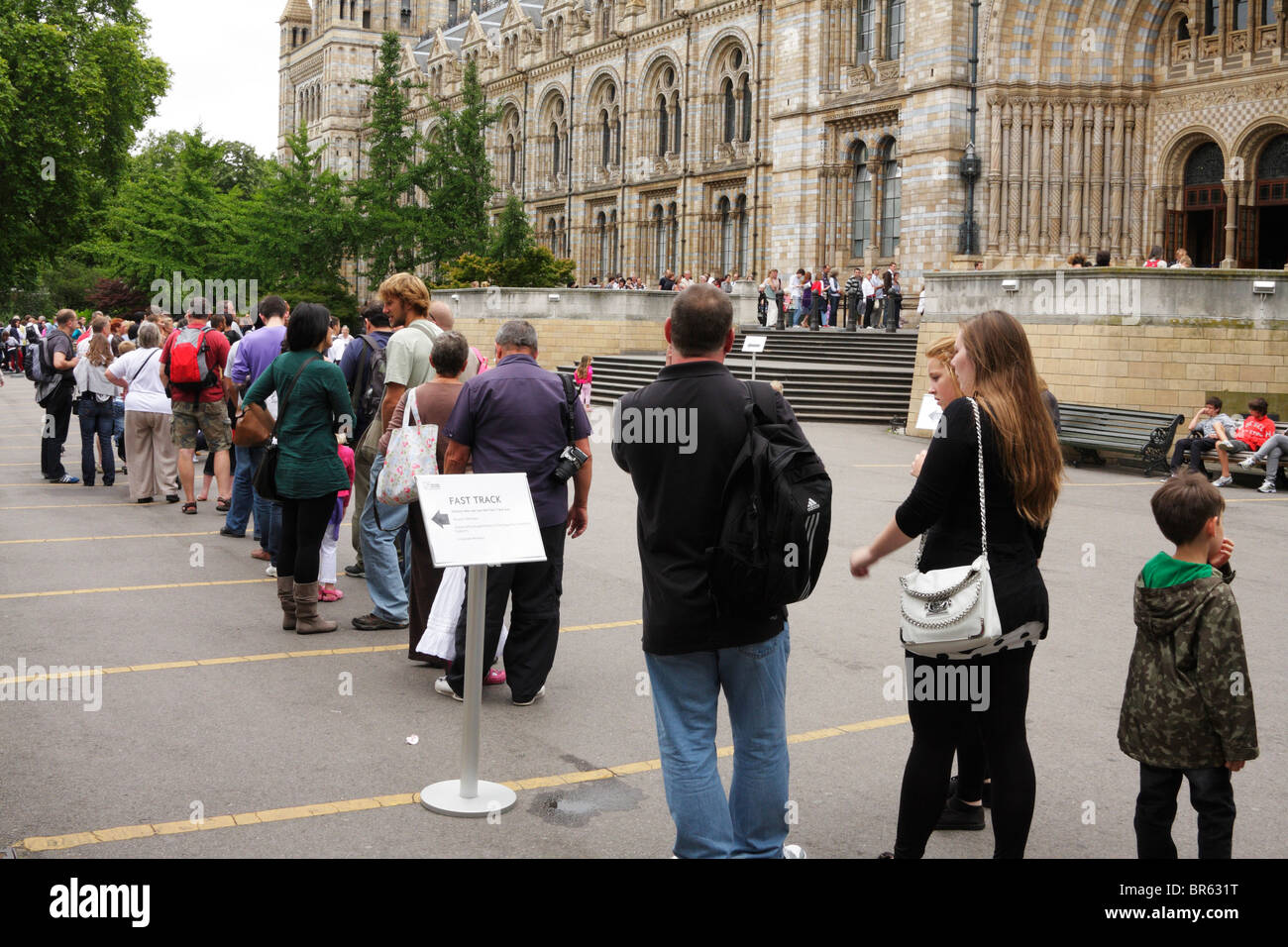 Queue of people waiting to enter Natural History Museum, London - Stock Image