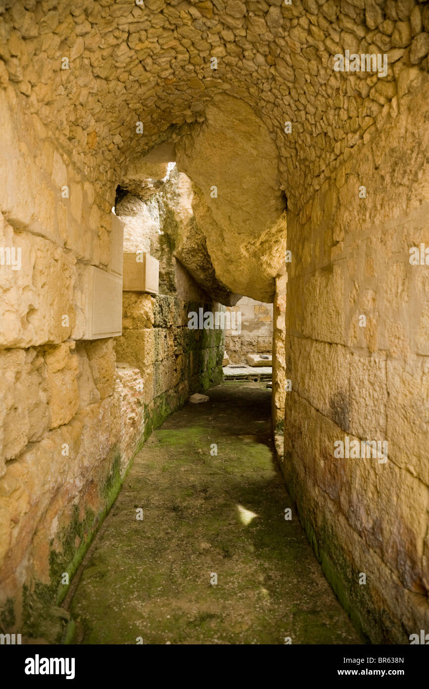 Corridor / hallway that circles the amphitheatre at the ruined Roman city of Italica / Itálica near Seville, Spain. Stock Photo