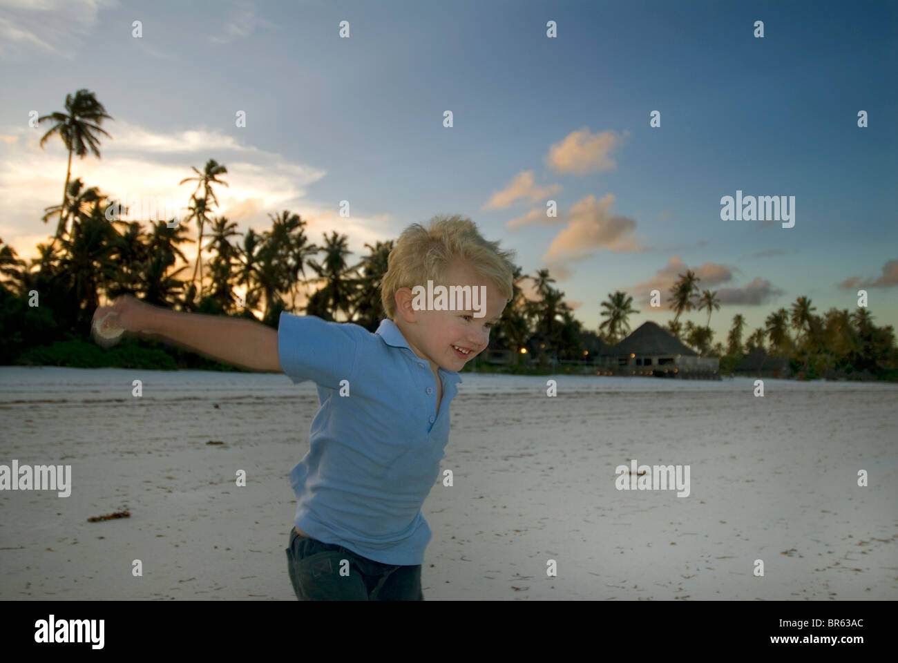 Child Playing on the Beach - Stock Image