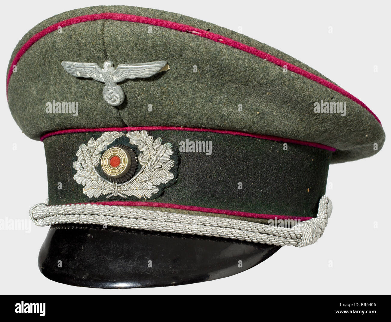 A uniform ensemble of a lieutenant, in the 2nd smoke launcher division. Visor cap of field grey wool with dark green - Stock Image