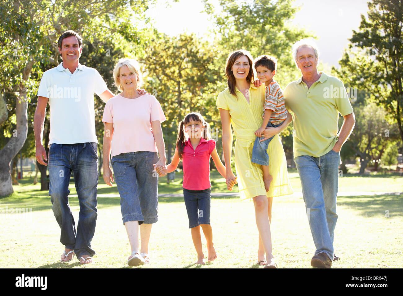 Extended Group Portrait Of Family Enjoying Walk In Park - Stock Image