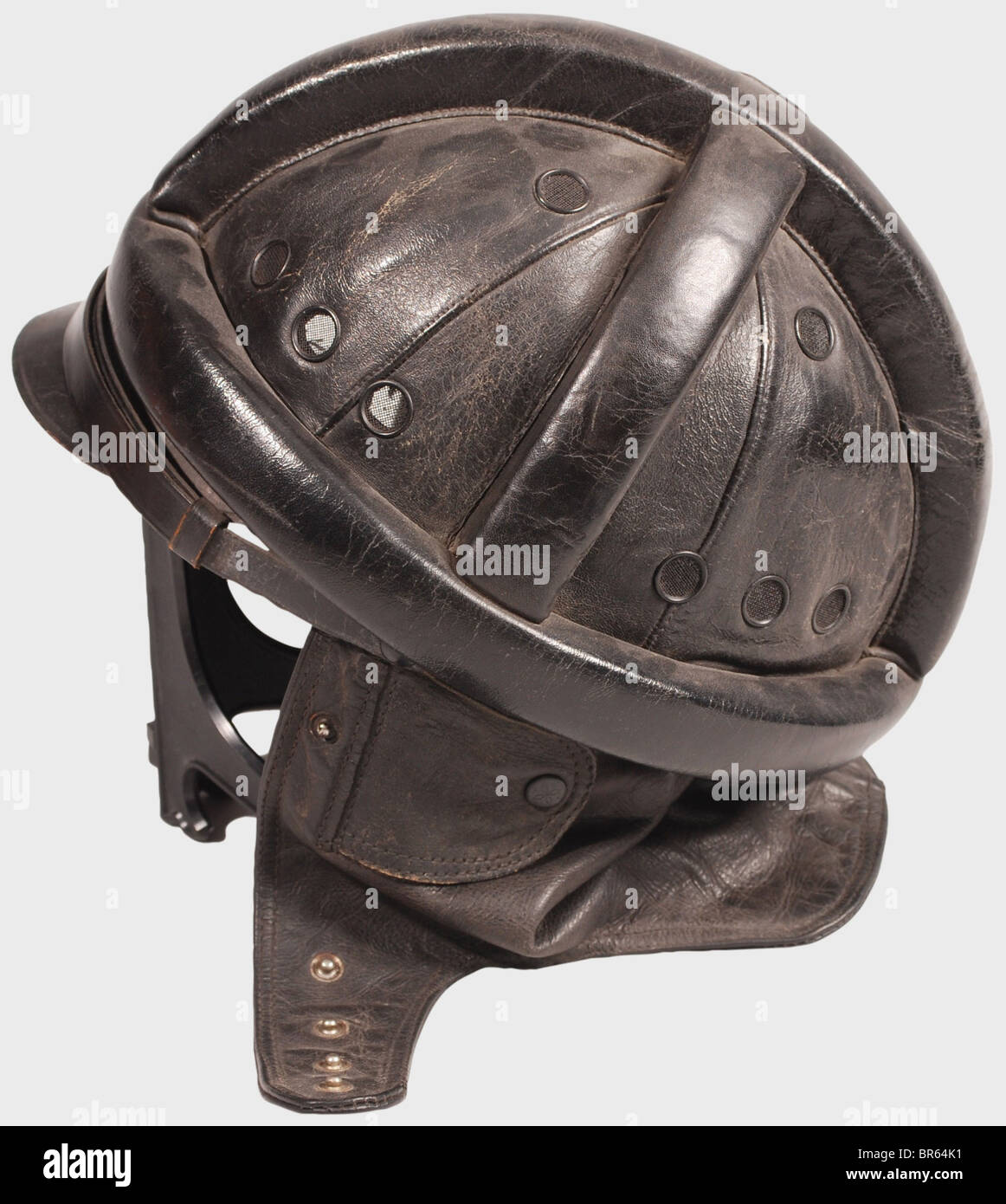A Luftwaffe motorcycle suit., A black leather crash helmet with protective cylindrical padding, a one-piece neck Stock Photo