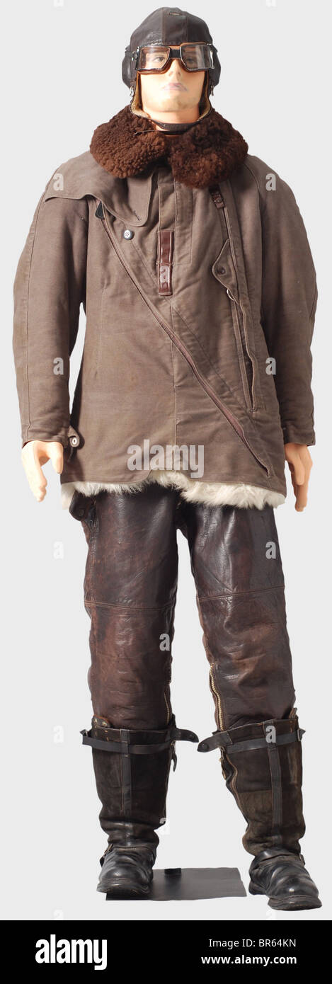 A special winter flying suit for Luftwaffe pilots., A LKp W101 brown leather flying helmet with fleece lining, and - Stock Image
