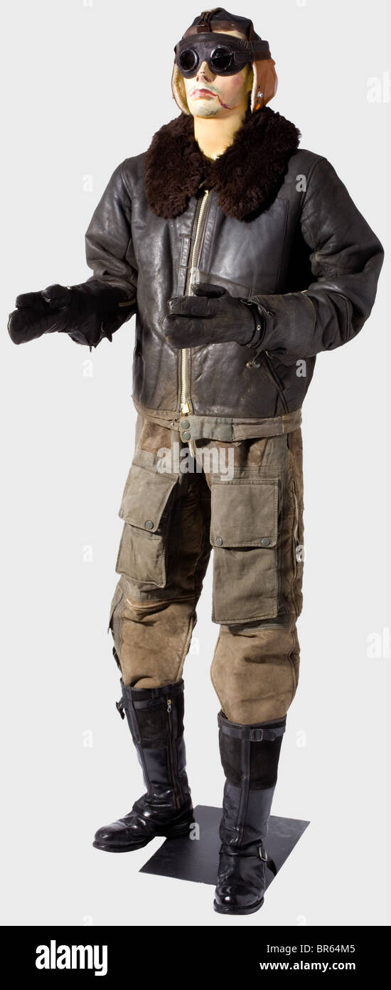 A special winter flying suit for Luftwaffe pilots., A flying helmet of adjustable webbing, bearing the range of - Stock Image