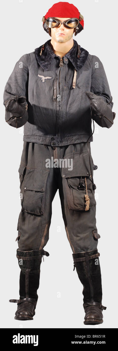 A special winter Luftwaffe flying suit for airmen., A LKp N101 mesh flying helmet with brown leather trim, two-point - Stock Image
