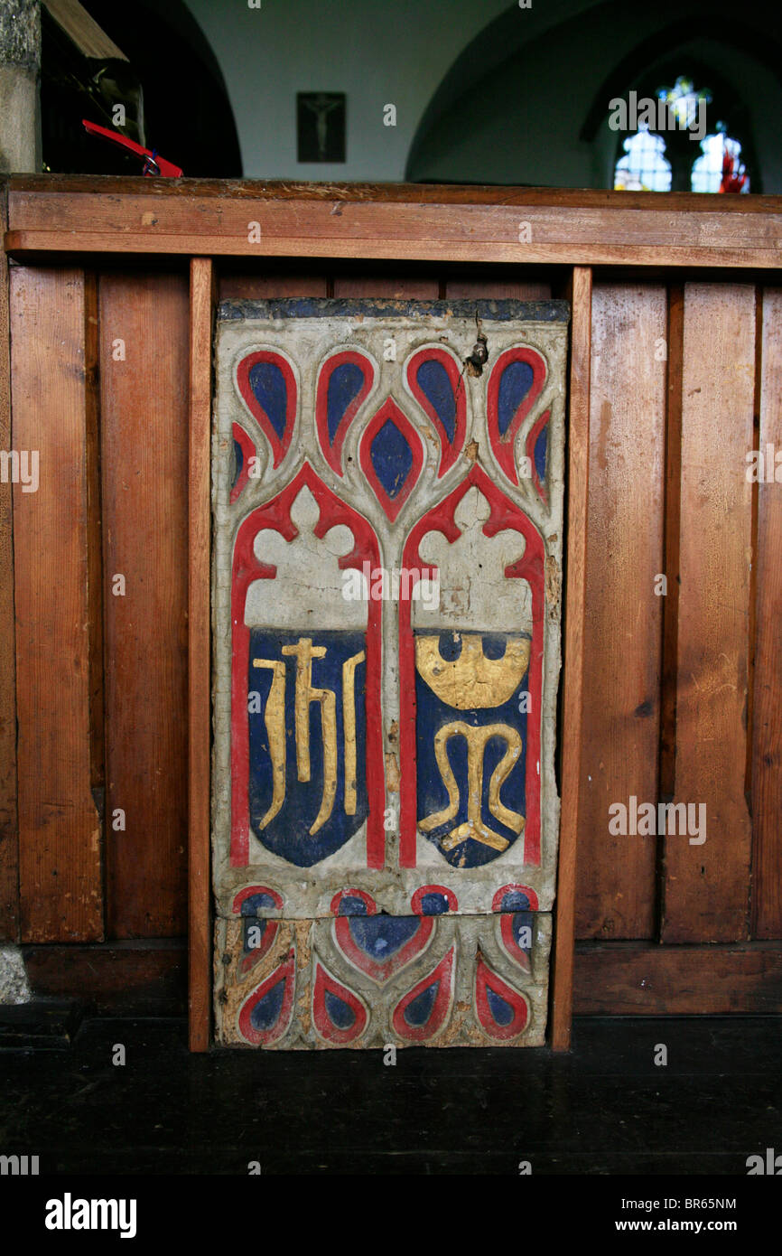 Painted Pew Ends, St Breward Church, Cornwall, depicting the Christograms of Jesus Christ and the Blessed Virgin - Stock Image