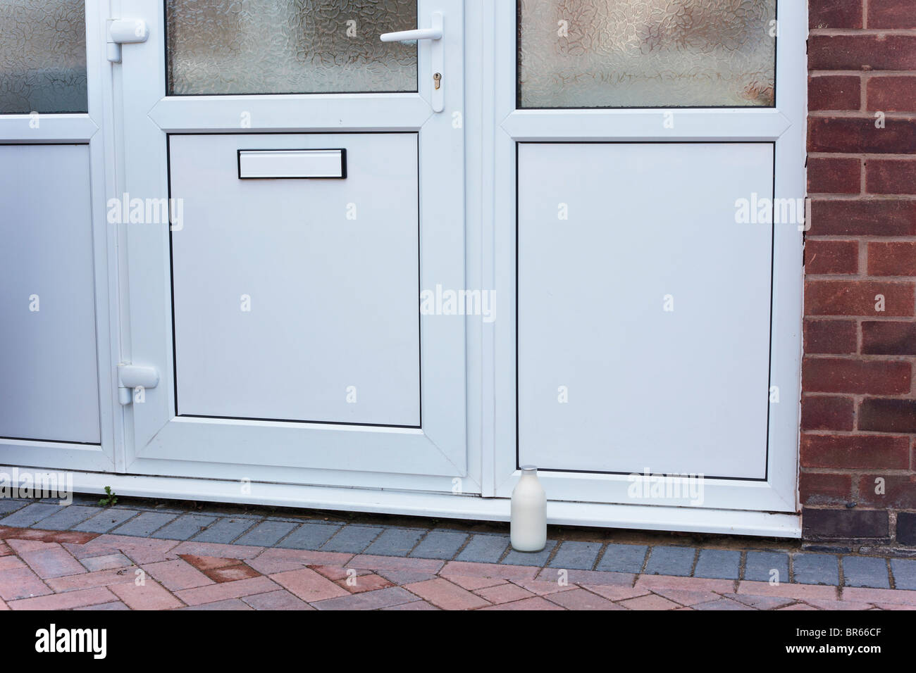 Pint of milk on the doorstep, UK - Stock Image