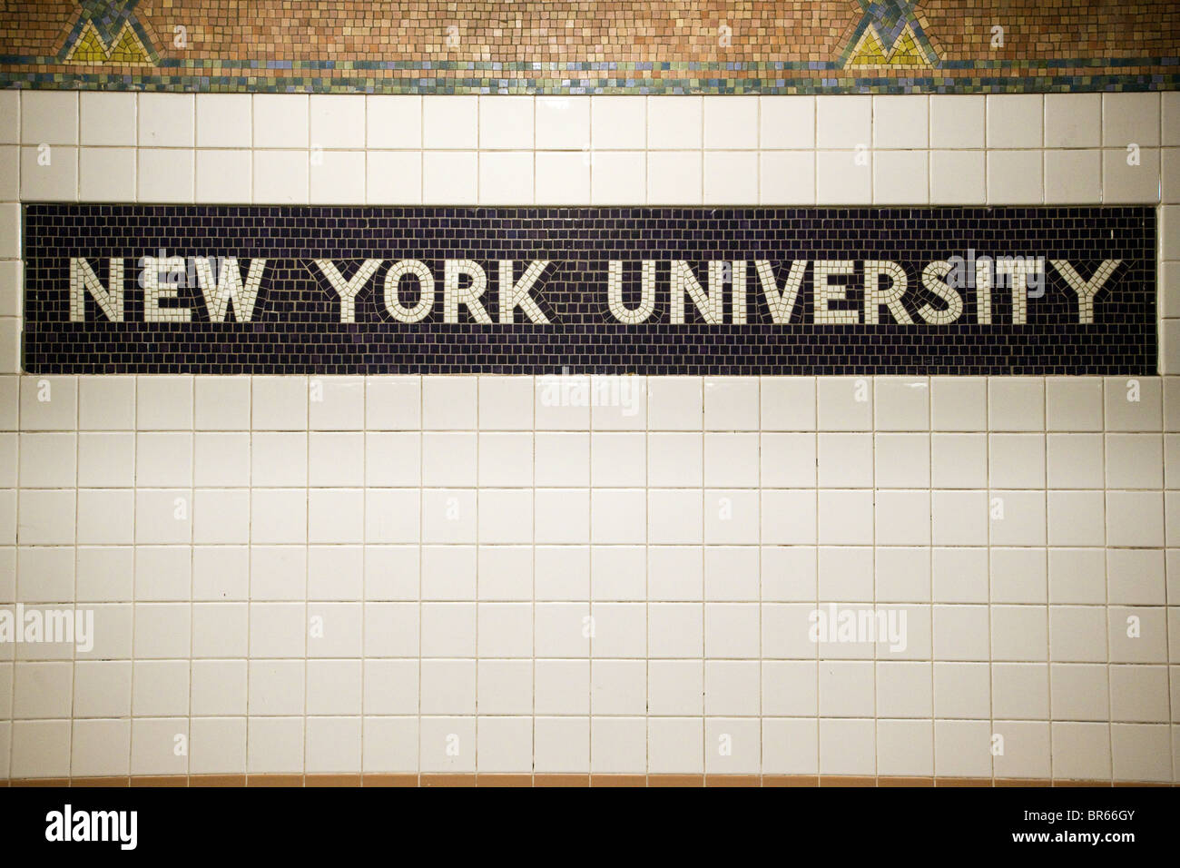 Decorative tile on the wall in the sheridan square subway station in decorative tile on the wall in the sheridan square subway station in new york for new york university stop dailygadgetfo Choice Image