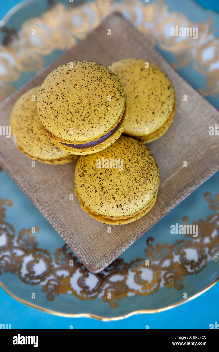 four yellow coffee flavored macaroon cookies - Stock Image