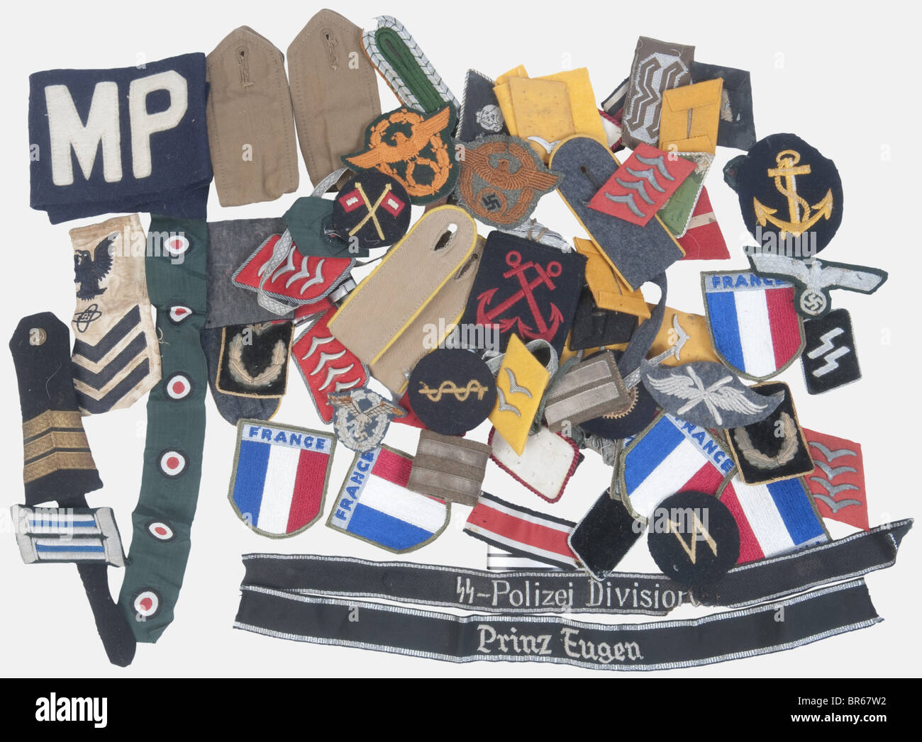 A big lot of various German Army cloth insignia., About 65 items, including sidecap cockades of the coastal artillery - Stock Image