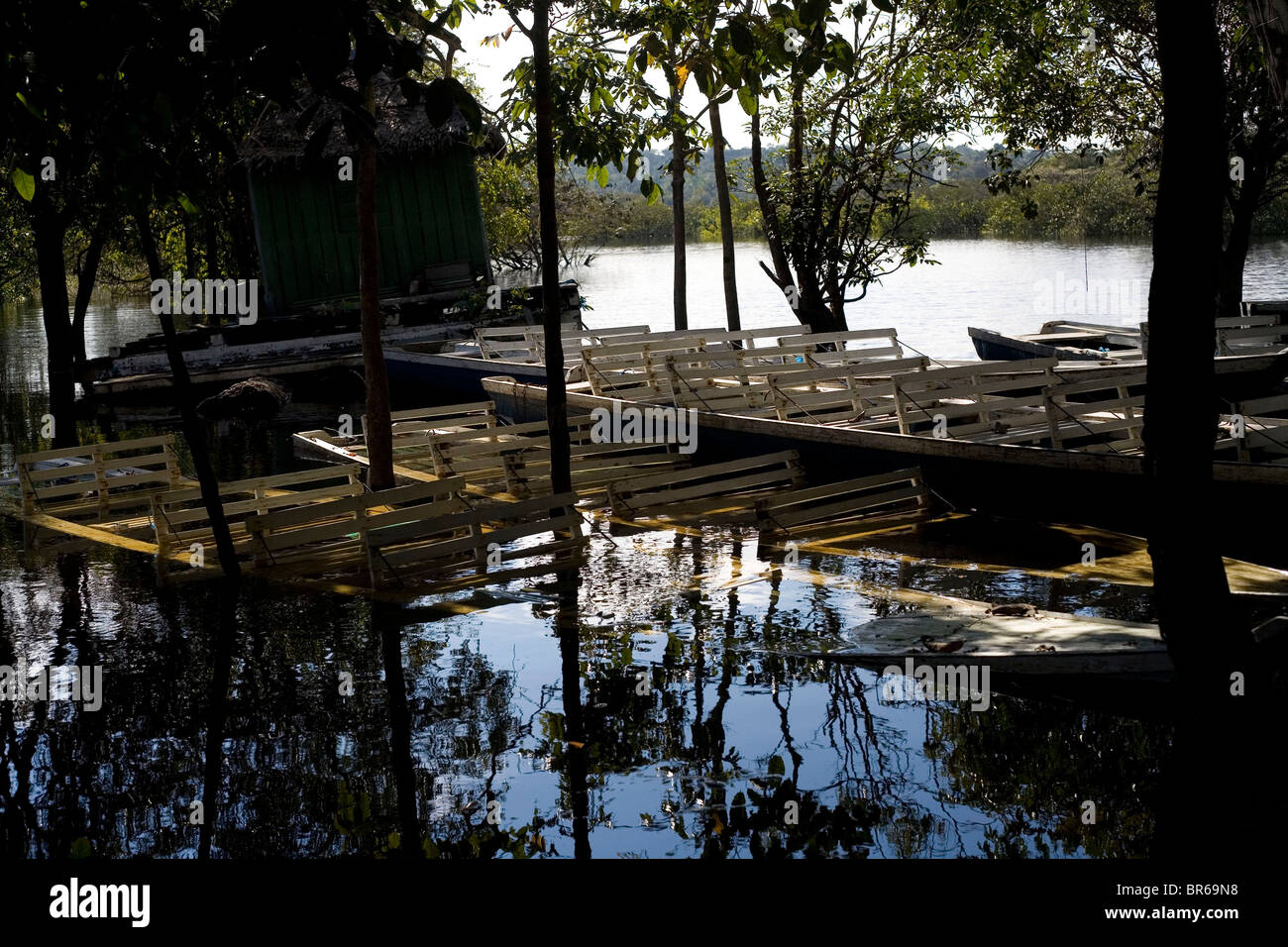 Waterlogged boats in the Amazon River, Brazil Stock Photo