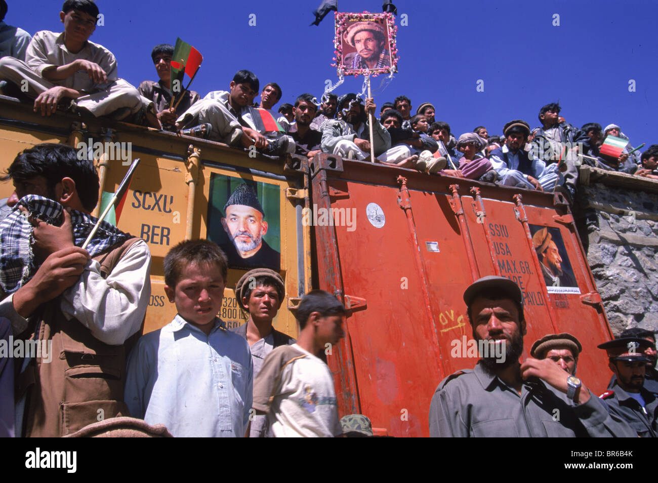 Boys and men line the roofs of buildings during a ceremony to honor Ahmad Shah Masood in the Panjshir Valley. - Stock Image